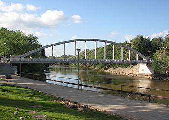 Pedestrians arch bridge in Tartu over EmaJõgi ...